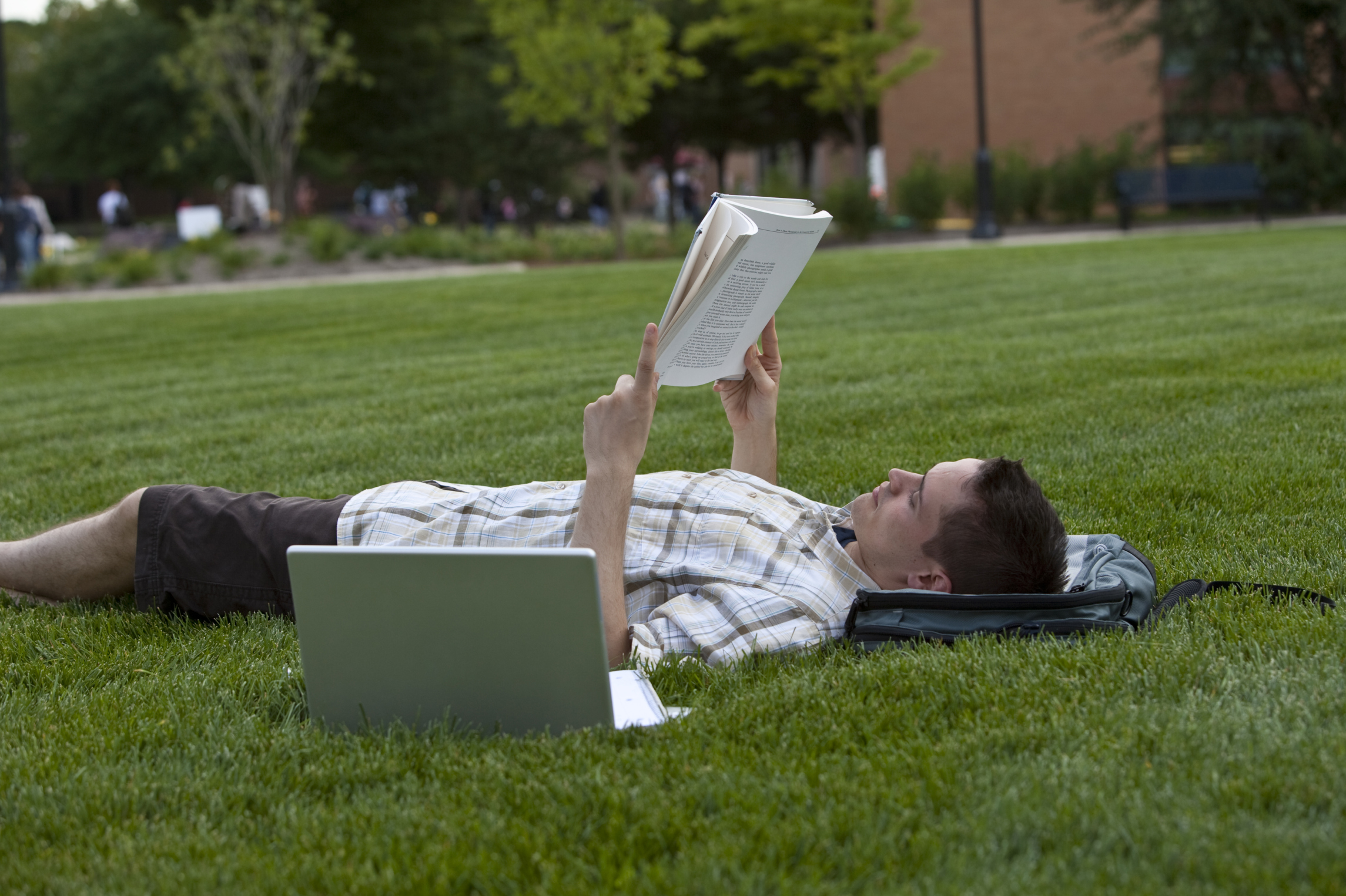 Student Laying Outside