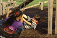 kids playing on tire swing.JPG