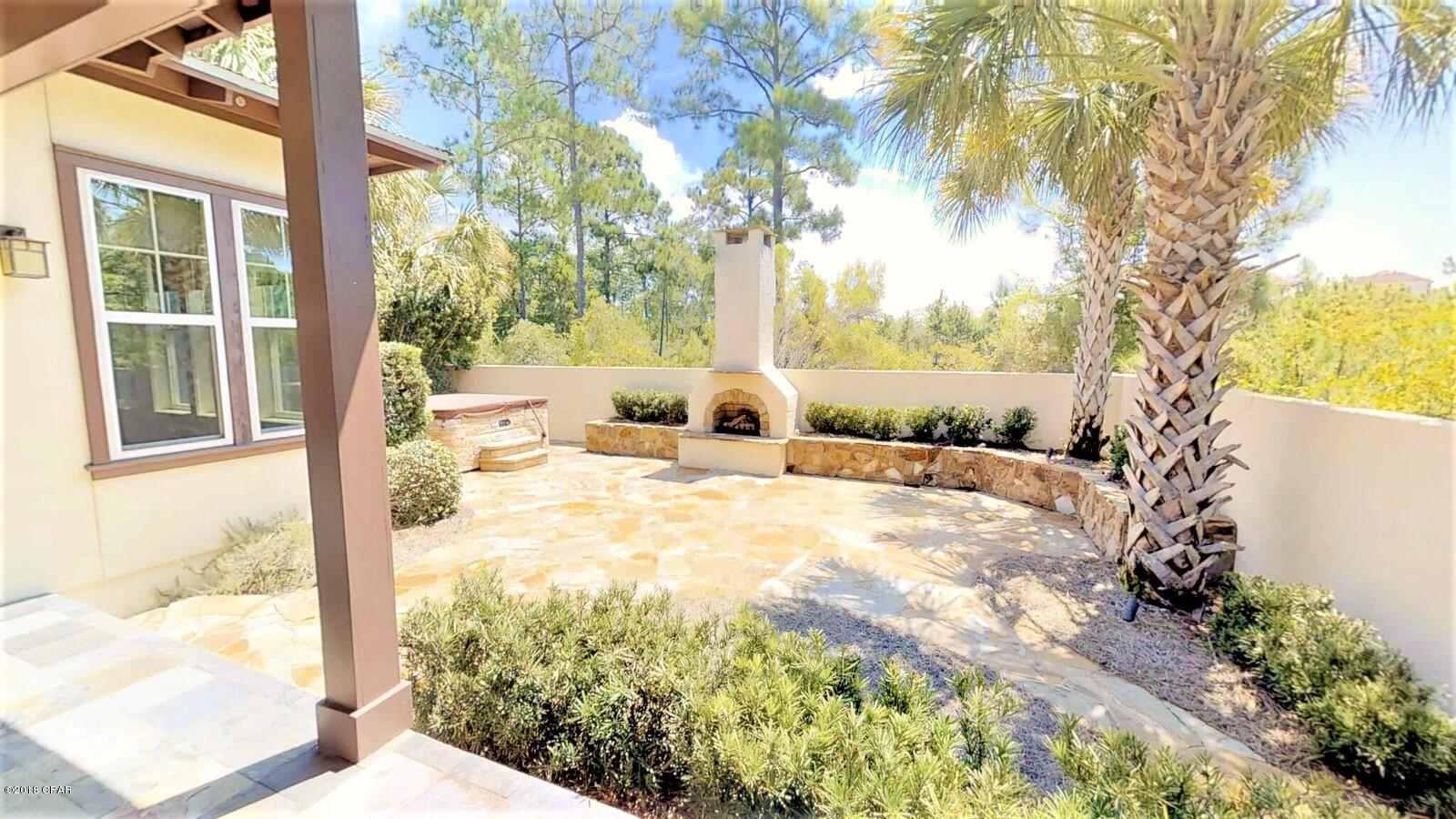 spacious backyard grilling area for sale 32408